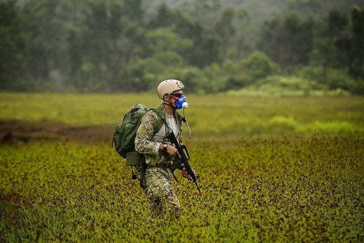 Senior Airman Wilson Jimenez, a combat controller, wears a mask designed to measure his maximal oxygen uptake during a jungle warfare training exercise. The data collected during the exercise allows researchers to determine the most physically demanding activities performed during an operation. (U.S. Air Force photo/Master Sgt. Jeffrey Allen)