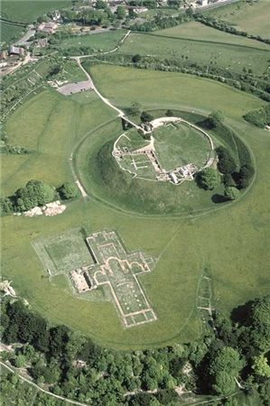 An aerial view of Old Sarum, Wiltshire, UK showing the motte and bailey castle and the remains of the Bishop's Palace. The Bishop's seat was transferred to nearby Salisbury in 1219 which gradually led to the decline of the Old Sarum site. When the settlement grew too big they needed to relocate so they decided to fire and arrow and where it landed they would build the new settlement, the arrow hit a deer and where the deer died they built Salisbury Cathedral