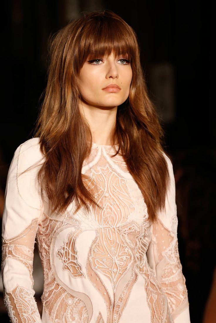 long light brown caramel hair with bangs...hmnnnnn