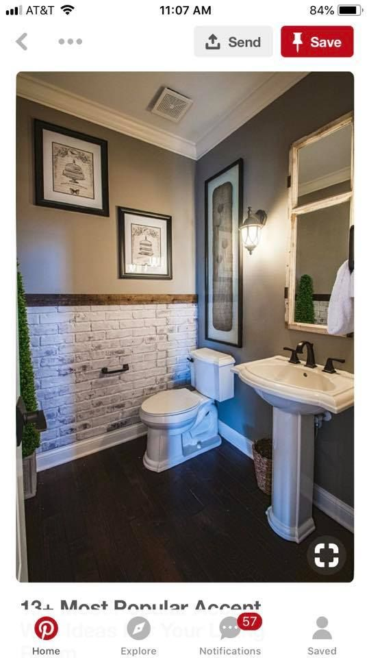 Faux brick white-washed wall in a bathroom using a panel of brick