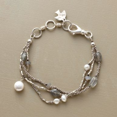 "Handcrafted tri-strand bracelet is a lyrical combination of moonstone, labradorite, cultured freshwater pearls and coin pearls set against faceted sterling silver beads. Lobster clasp. Made in USA. Exclusive. 7-1/2""L."