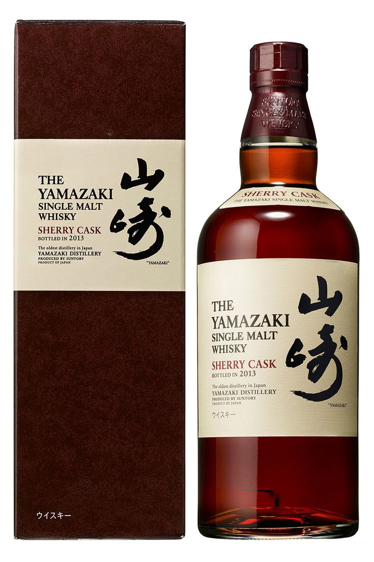 """This promotional handout picture released to AFP on November 4, 2014 by Japan's liquor maker Suntory shows the company's single malt whisky """"Yamazaki Single Malt Sherry Cask 2013"""". The whisky was named the world's best for the first time by a prestigious guide released on November 3, 2014 which failed to place a Scotch in its top ranking. AFP PHOTO / SUNTORY HOLDINGS ---EDITORS NOTE---RESTRICTED TO EDITORIAL USE - MANDATORY CREDIT """"AFP PHOTO / SUNTORY HOLDINGS"""" - NO MARKETING NO ADVERTISING…"""