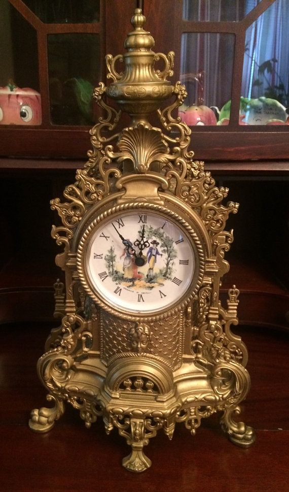 Vintage French Rococo Style Mantle Clock, Hermle Germany made Quartz 2100 AA Battery, Castelli Italy is where the ceramic face was made. Castelli Is a