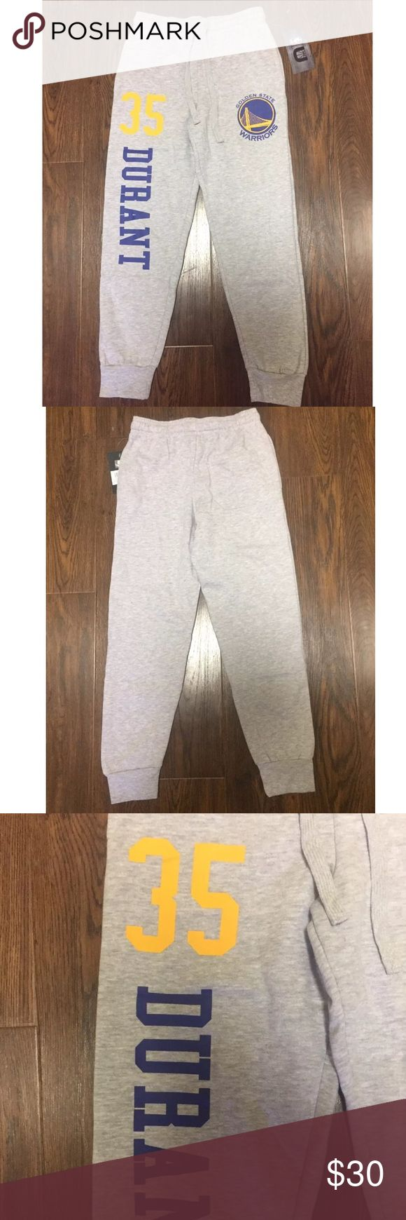 Golden State Warriors Kevin Durant Joggers XL Color : Gray   Size : Youth XL (18-20)   BRAND NEW WITH TAGS   Two front side pockets    One back pocket    Drawstring front closure    Elastic waistband    35 DURANT DOWN RIGHT LEG    WARRIORS LOGON ON LEFT LEG    COME FROM A SMOKE FREE HOME UNK Bottoms Sweatpants & Joggers