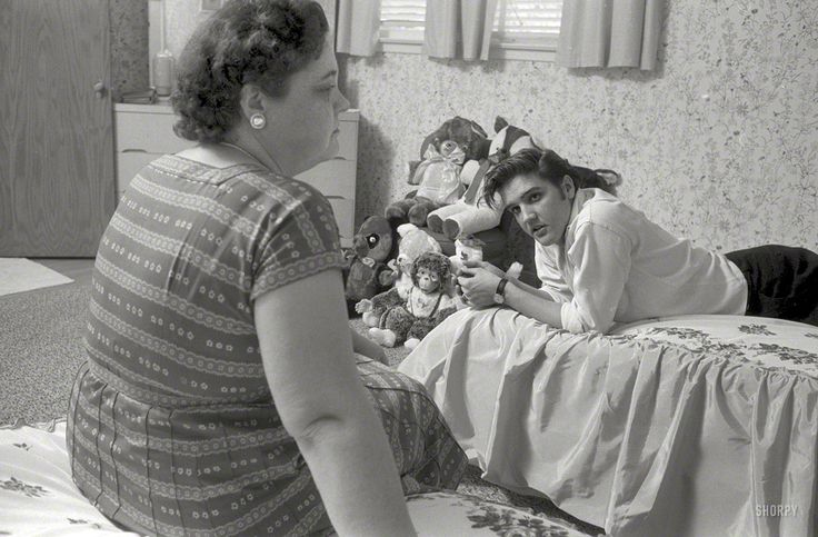 1956. A young Elvis Presley at home in Memphis with mom Gladys, and an impressive assortment of stuffed animals.