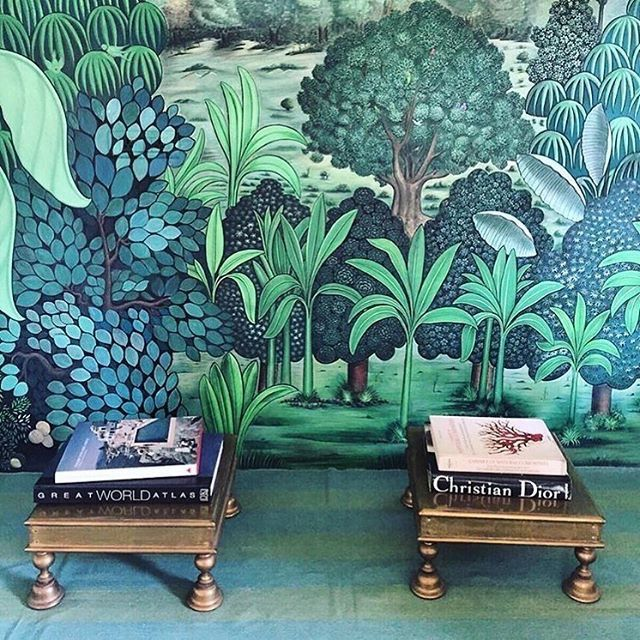 I love every inch of this wallpaper, gold-squatty-table/stools & books.