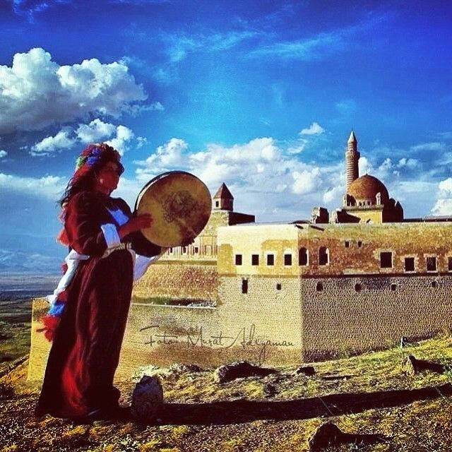 Young Kurdish Woman in traditional Dress playing the Daf in the City of Doğubayazıt previously Bazid. The Daf is a large Iranian Frame Drum used in popular and classical Music. The earliest evidence of the Daf dates back to Iran's Sassanid Era. The Kurds as iranic People use the Daf in many various ceremonies.