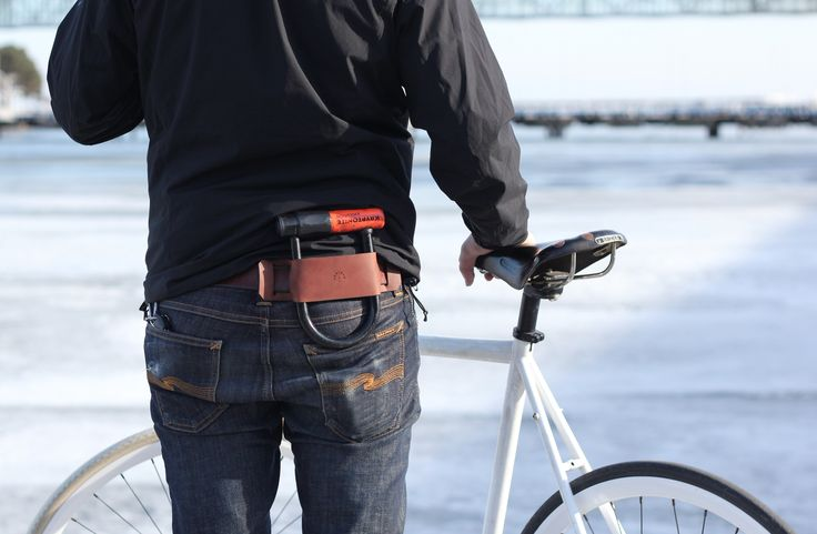 "Contour and Co's  U-lock holder was designed for function and ages beautifully with time. It threads onto your belt and holds your lock securely in place while you ride. Handcrafted in Toronto, Canada Boomer Brown Leather Size: 9.75"" x 2.25"" Belt slots: 1.625"" Long   #bike #fixie #fixedgear #singlespeed #trackbike #cycling #ulock #lockholster #bikelock #cycle"