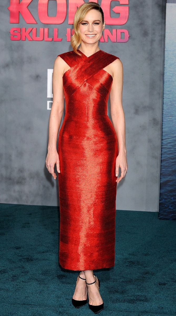 Brie Larson in a red Oscar de la Renta midi dress