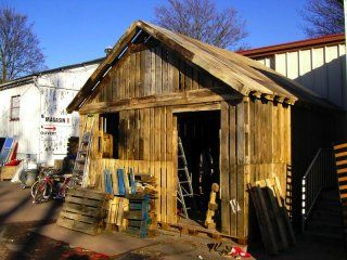 Pallet House and Shed, with amazing looking pallet siding