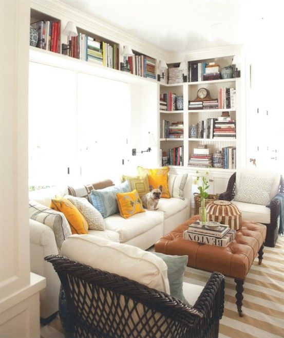 small spaces : living rooms | the handmade home Shelves over and around the window... Maybe?
