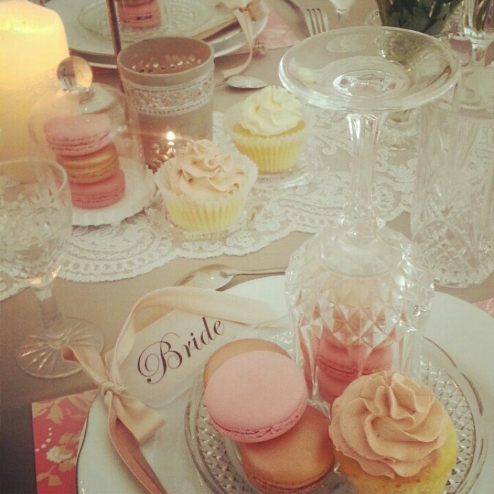 Table styling for a magazine shoot. With macarons and cupcakes. Surrounded by crystalware