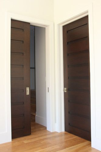 #bldgproductoftheday I am in love with these beautiful dark wood interior doors from Appalachian Woodwrights! Very classic design, and it looks like they have pocket versions as well. Great way to step up a home's interior.