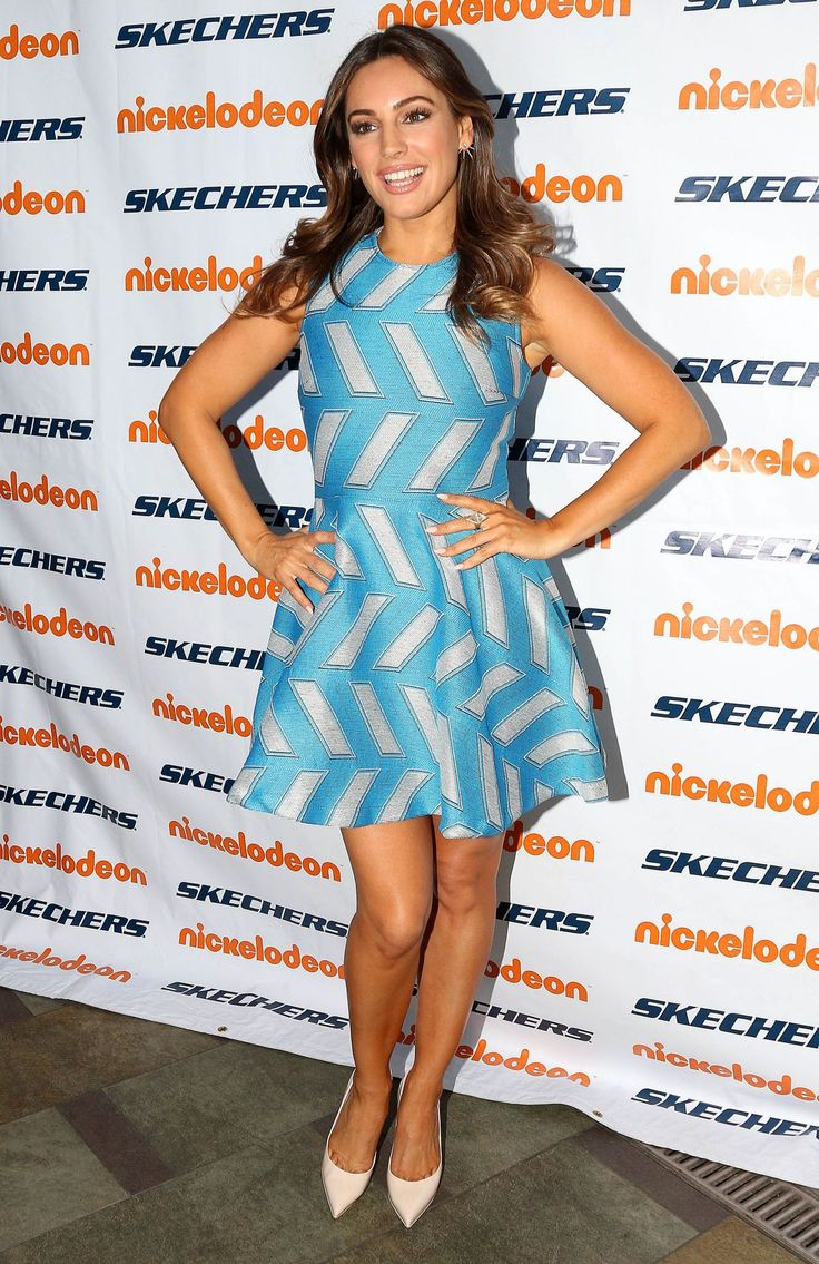 Kelly Brook looked Spring-perfect at the 6th Annual Skechers Pier to Pier Friendship Walk in a $445 Opening Ceremony Slash Pool Fit and Flare Dress: Her ce