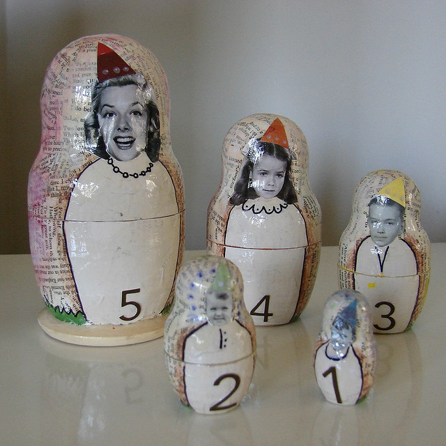 Buy a blank set of dolls and mod podge your family's faces on them, or your childs face from birthday