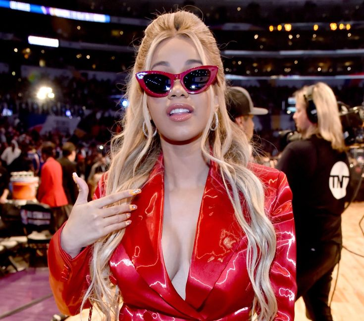 A video that shows Cardi B dancing to Fergie's National Anthem performance is presented in this article. The video is a mashup but it's going viral on social media.