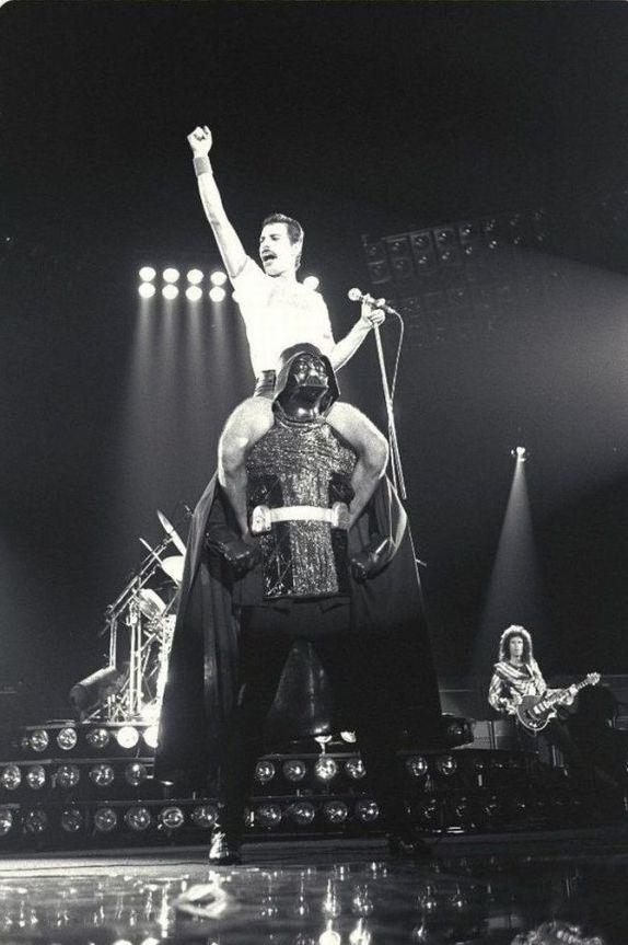 Freddie Mercury sitting on Darth Vader's shoulders. 1980.