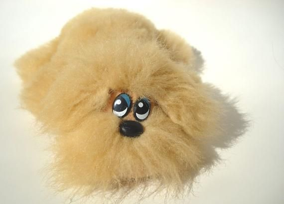 This Shaggy Vintage 1980s Pound Puppy Reminds Me Of Chewbacca From Star Wars This Little Pup Has A Lot More Fur Than Y Pound Puppies 1980s Toys Childhood Toys