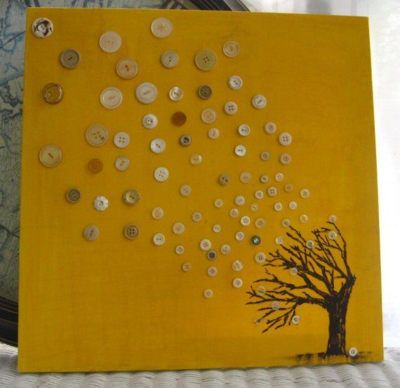 designing with buttons on a canvas is a cute idea! The white #buttons all scattered around the canvas represent the #leaves blown off the #tree