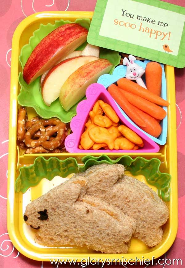 Easter themed lunchbox with bunny shaped sandwich,pretzels,apples, and baby carrots - #BlueRibbonBread