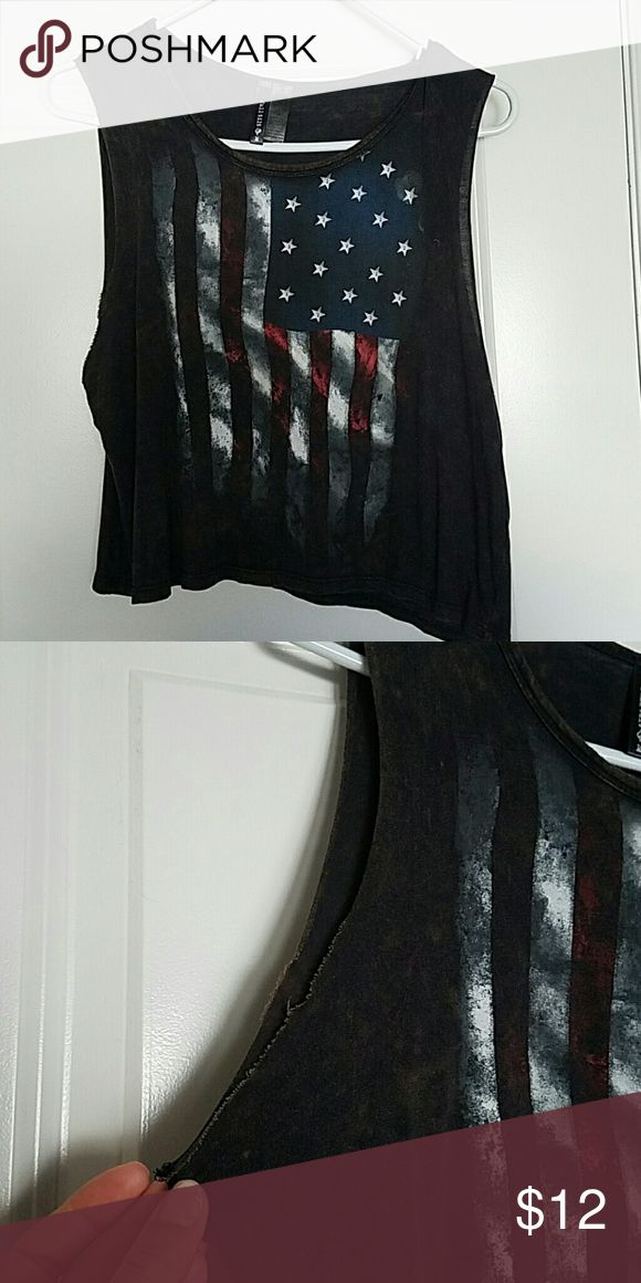American flag crop top muscle tank Flowy crop top with distressed look. The black looks acid washed and has wide arm opening. Tops