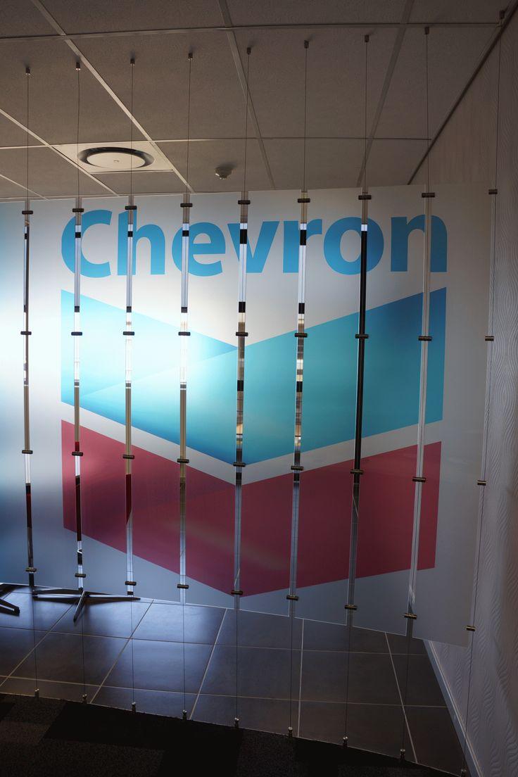 A privacy screen suspended from the ceiling at Chevron.