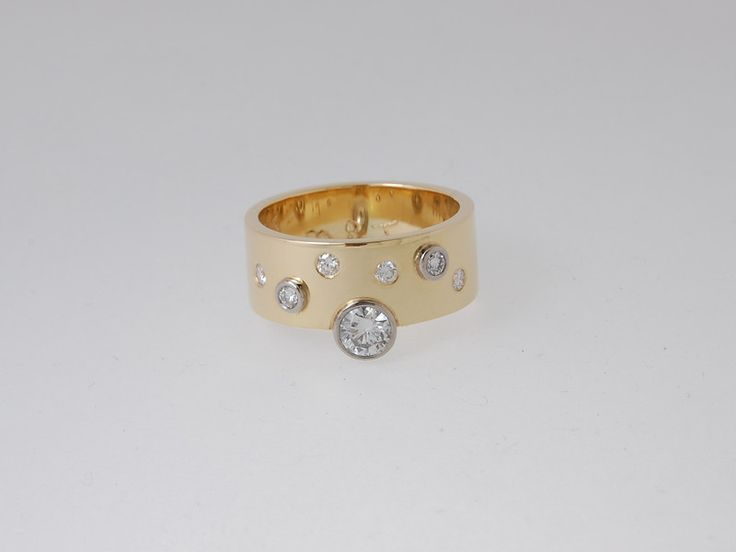 -CM407r- Yellow gold band with several different size diamonds set either inside the band or on top in white gold rub over setting.  This ring is sold. Let us create a special ring for you. Check out our website https://jewelbeetle.co.nz or our gallery on smugmug https://jewelbeetle.smugmug.com