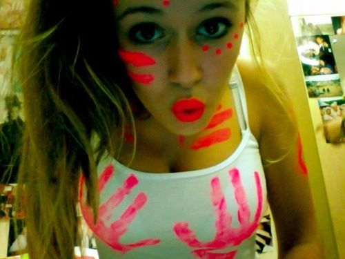 White tank top with neon paint. Makes for a great rave outfit