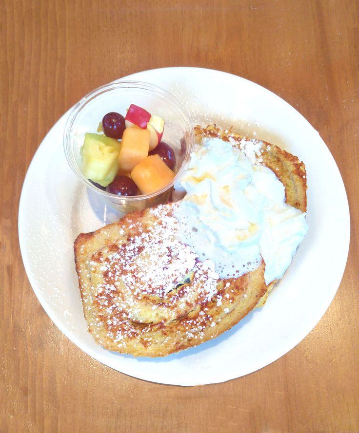 Cinnamon Swirl French Toast: Two generous pieces of cinnamon swirl loaf, topped with maple whipped cream and served with a side of fresh fruit.  Venue: www.templessugarbush.ca Photo Credit: http://www.stephaniewhite.style/bring-on-the-maple-at-temples-sugar-bush/