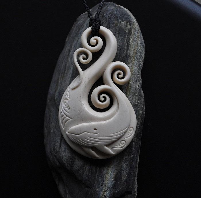 Bone Whale carved on Fish hook. $195.00, via Etsy.