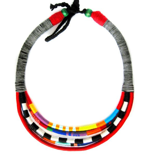 Choker Style Rope African Necklace. The necklace features five handwoven tribal strands which are made from cotton thread and wooden beads. It is