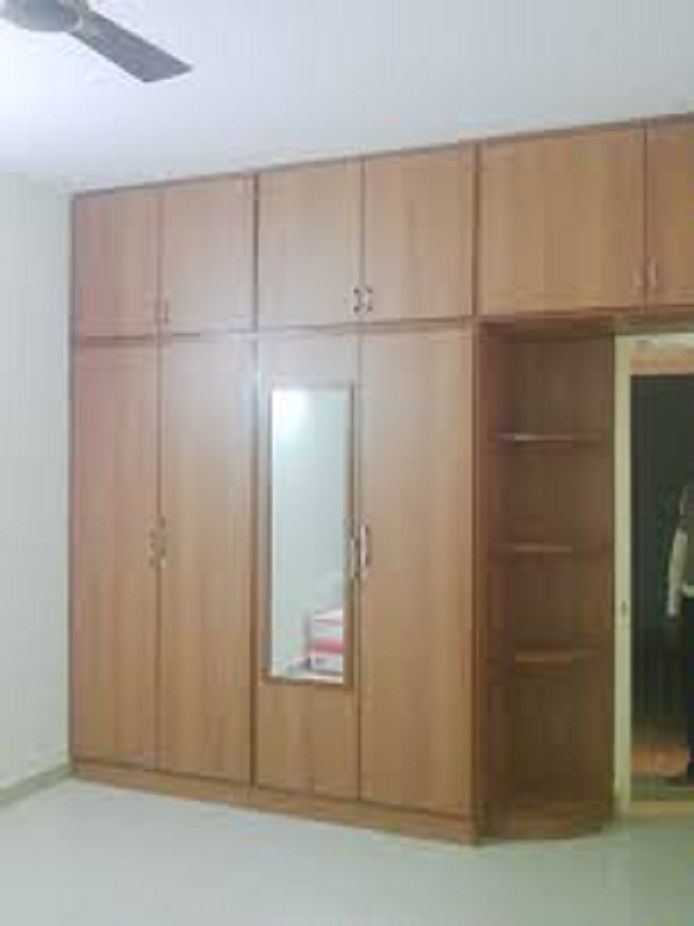 Awe Inspiring Storage Cabinets For Bedrooms With Corner Wooden Shelves And Partial Overlay Cabinet Doors Also Rectangular Wood Framed Mirrors