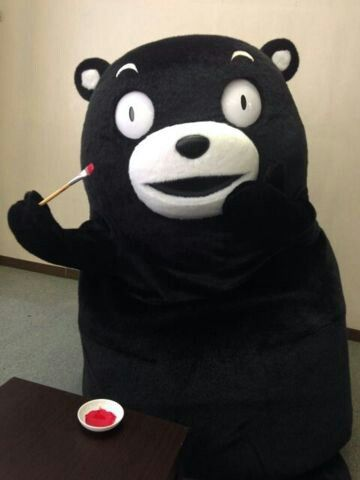 Kumamon - oh my god he's painting on his little cheeks. It's so cute it hurts. >-