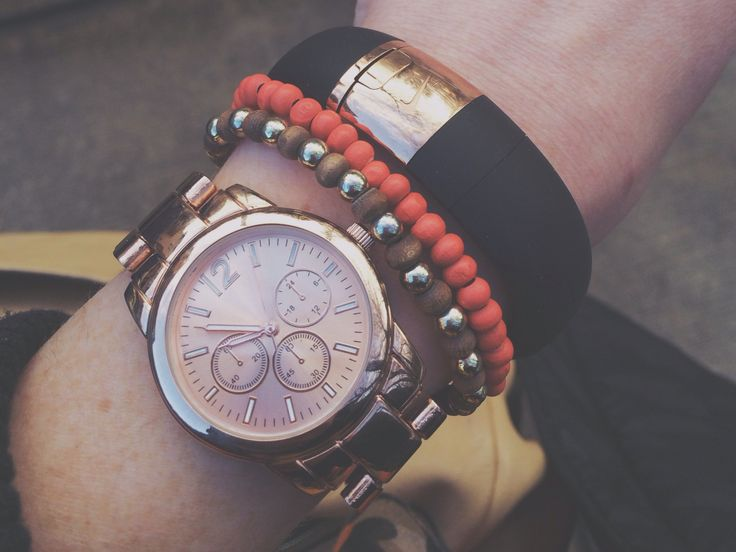 Rose gold watch and nike fuel band. Love.