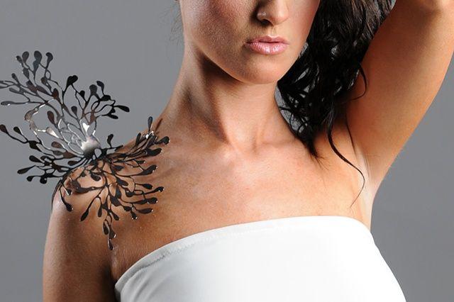 "Cheryl Eve: ""Emergence""  Shoulder Brooch 2010  Oxidized copper"