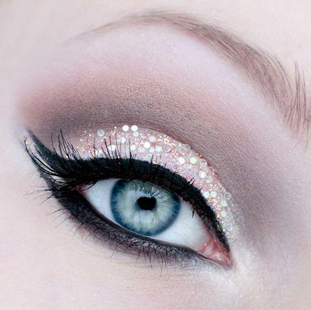 Embellished eyelids with black winged eyeliner