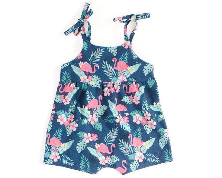 Easy to sew playsuit sewing pattern for baby and toddler girl, with ties on the shoulders and no snaps at the crotch.