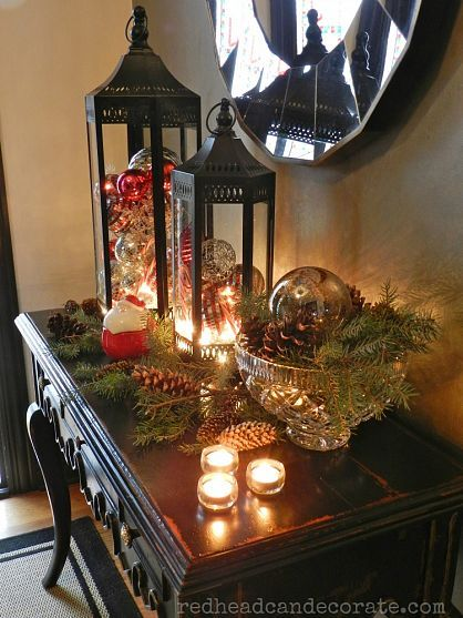 Put ornaments in glass lanterns and fill bowls with pine cones and pine needles to create a fabulous Christmas vignette.