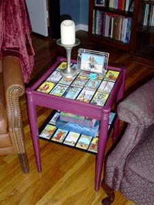 saw this years ago. a tarot card end table. goes well with an ouija board coffee table. :)