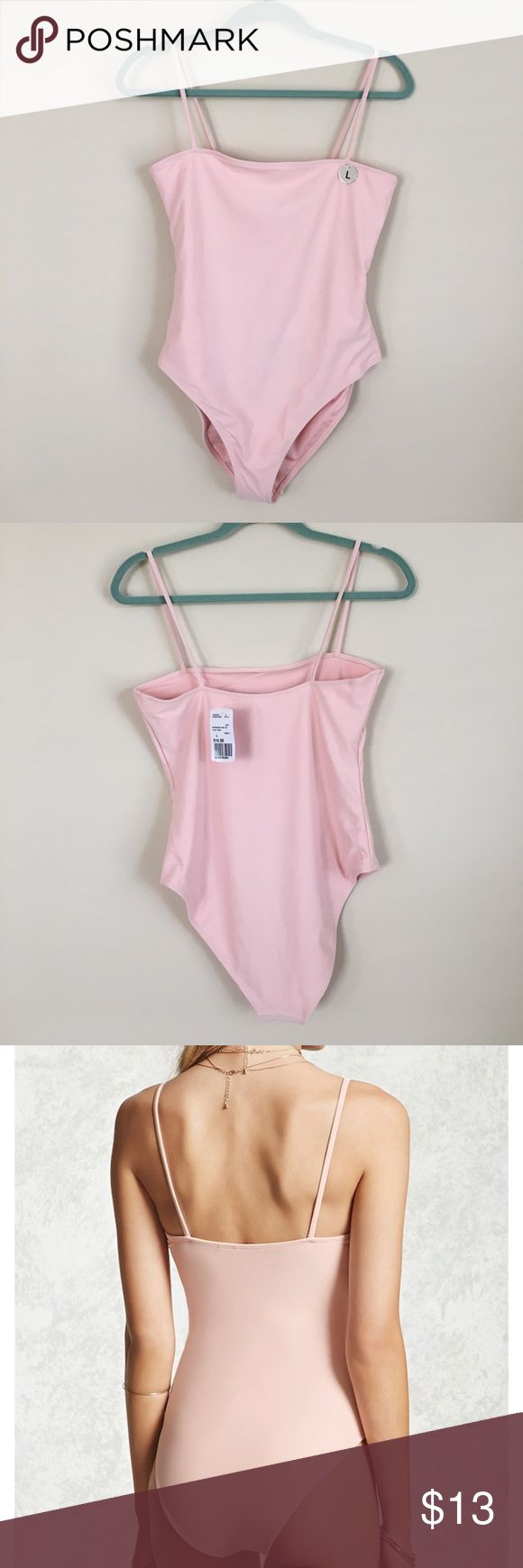 Light Pink Cami Swimsuit NWT Light Pink Cami swimsuit from Forever 21! Never been worn. Size large. Selling because it's slightly too big for me & it was final sale. High cut and so cute! Forever 21 Swim One Pieces