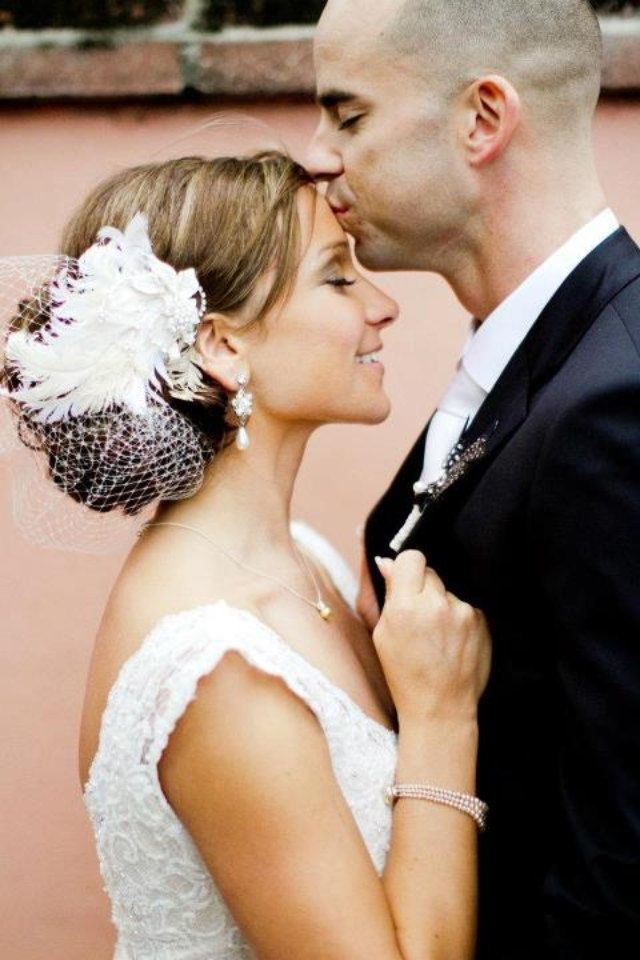 Wedding Headpiece with Bridal Birdcage Veil -- Curly Feathers with Rhinestone Fascinator and the NEW Jewel Birdcage. $86.95, via Etsy.
