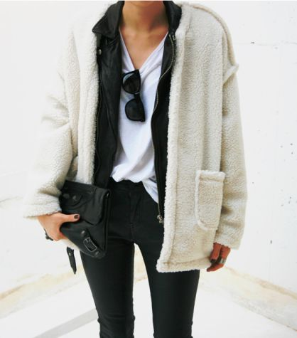 black clutch and chunky cardigan