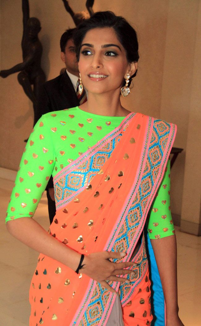 Fashionista Sonam Kapoor looked stunning in neon saree from designer Manish Arora. #Bollywood #Style #Fashion
