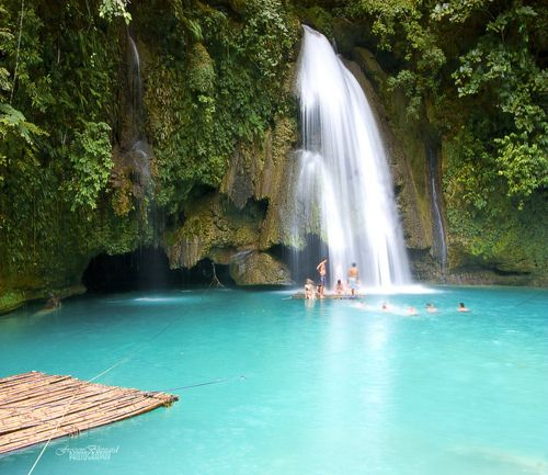 Kawasan Falls, The Philippines. The view of the sky when you're on your back floating in the water is absolutely BREATHTAKING!  And you get to go behind the waterfall on a raft!  And the scenic walk up to the waterfall was half the fun :)