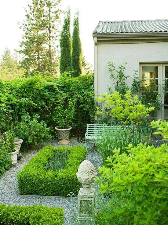 .Lovely green shrubs and trees.  This type of landscaping is low maintenance and good year round.