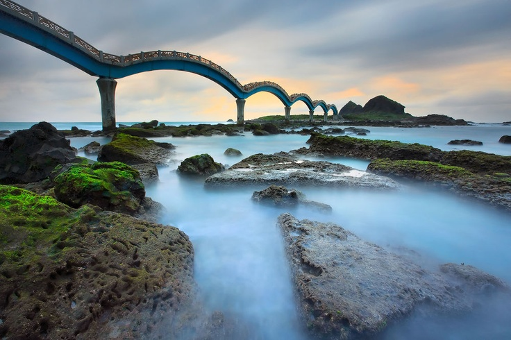 "The Eight Leaped Bridge, connecting Taitung in Taiwan to an island called ""Terraces of the Immortals"".  This is a walking bridge.  I don't recommend designing a bridge like this for cars unless you include several ""sick stops"" along the way."