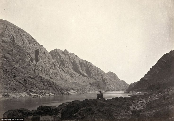 Rockies: A man sits on a shore beside the Colorado River in Iceberg Canyon, on the border of Mojave County, Arizona, and Clark County, Nevada in 1871