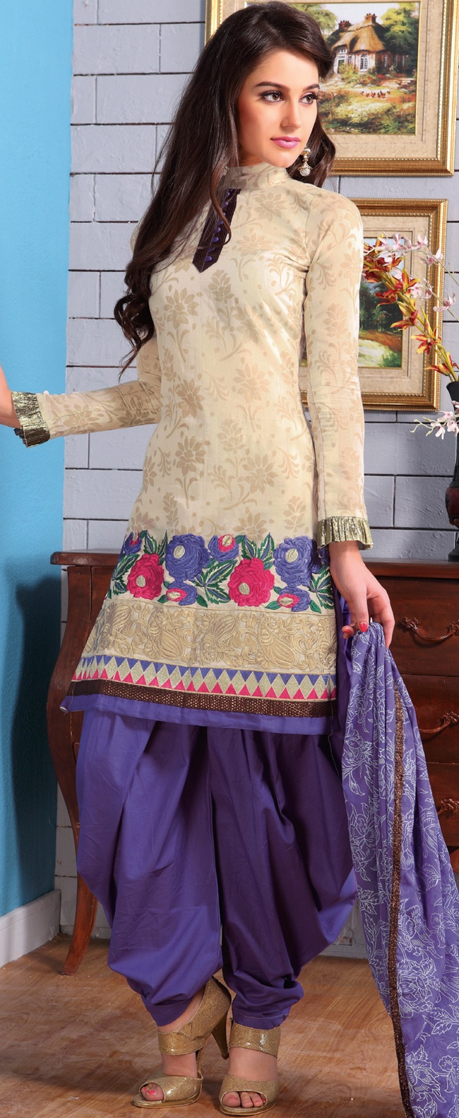 A desire that evokes a sense of belonging with a striking details.   This light cream cotton salwar kameez have amazing embroidery and patch work is done with resham and zari work.   Embroidery on kameez is highlighting the beauty of this suit.   Contrasting purple cotton salwar and purple dupatta come along with this suit.   Slight Color variations are possible due to differing screen and photograph resolutions.