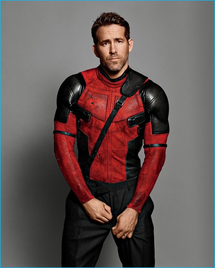 Appearing in a GQ photo shoot, Ryan Reynolds poses for a cheeky image in his Deadpool costume.