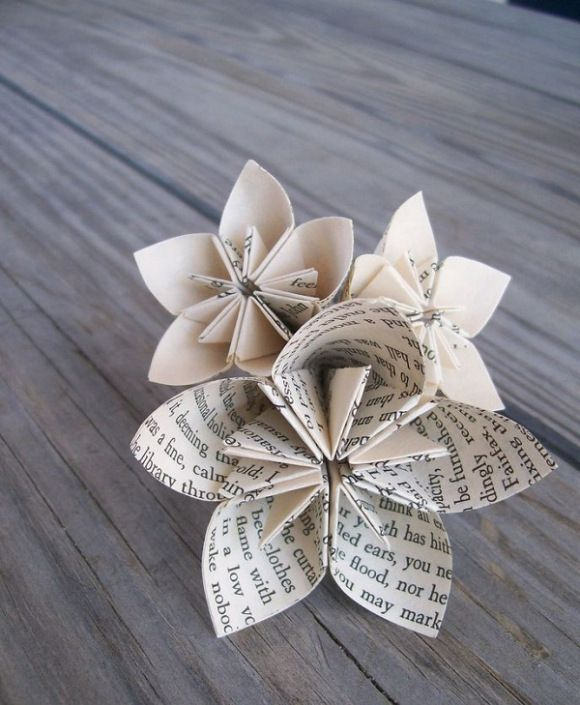 Newspaper flower craft. Could be nice as decorations - affordable, easy to make, cleaner than real flowers.